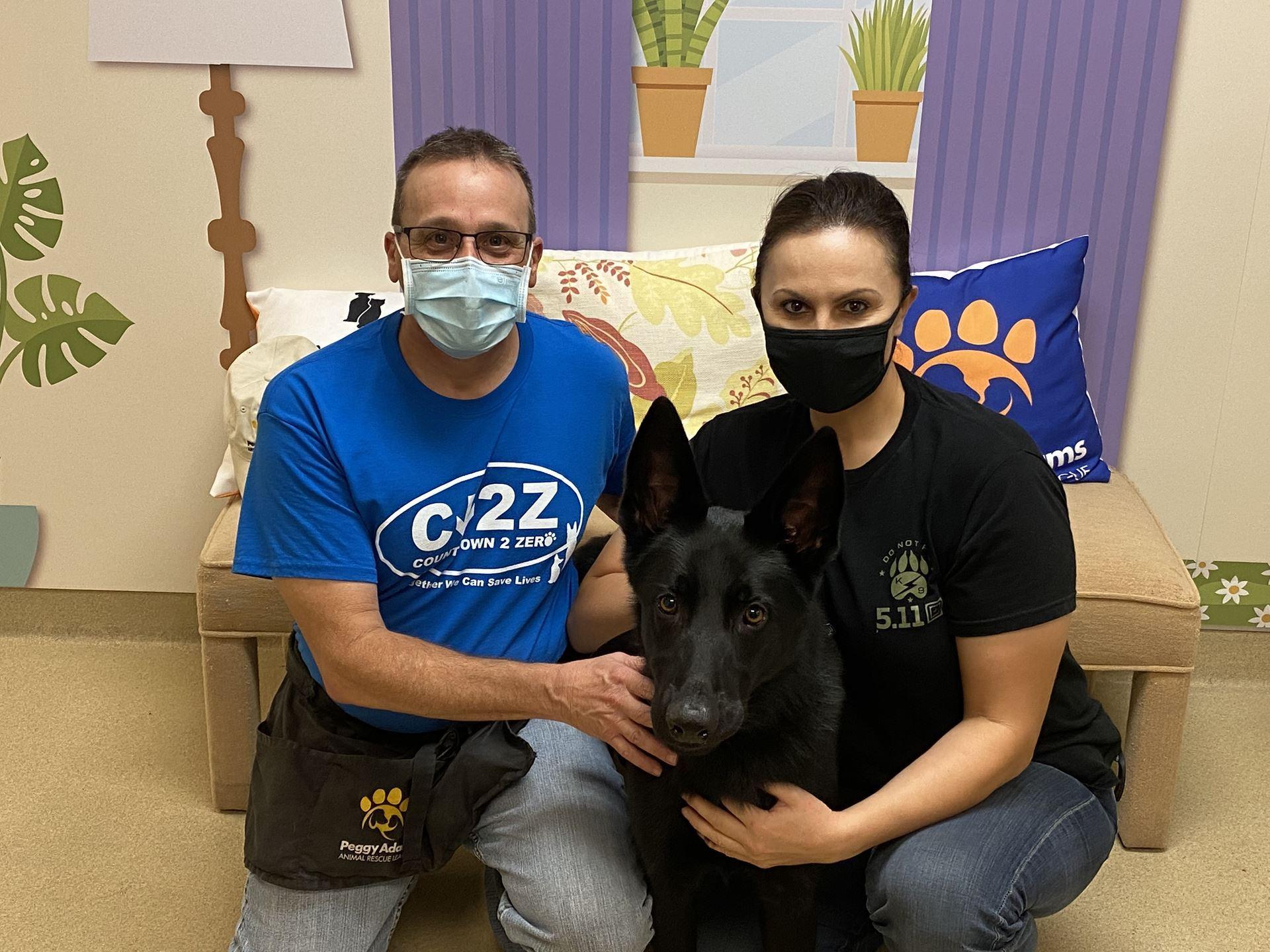 couple with adopted dog- Ninja